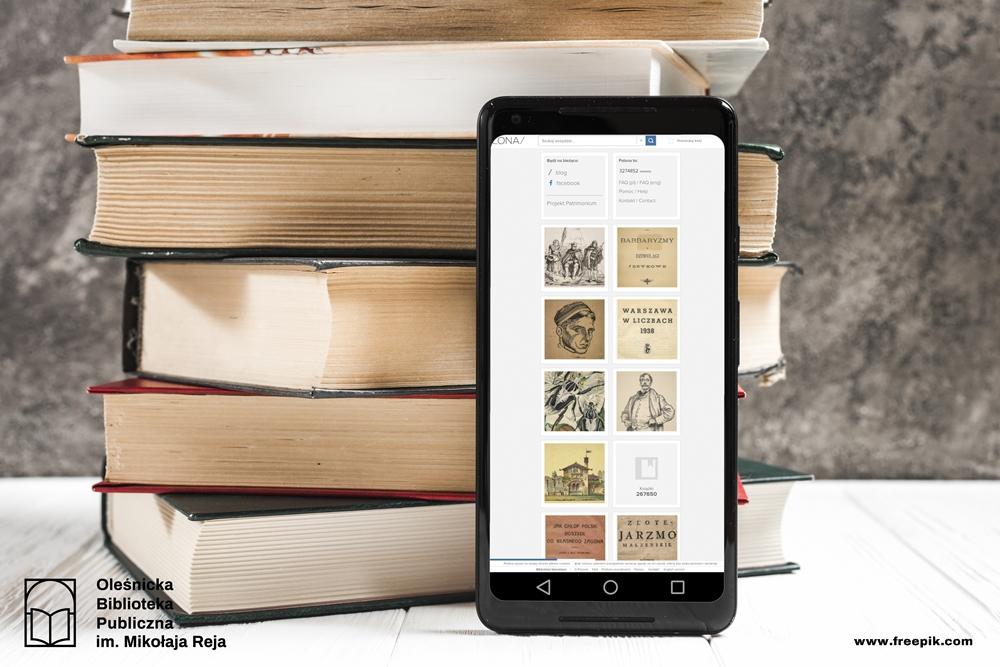 Telefon oparty o książki. Na wyświetlaczu strona główna POLONY